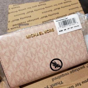 Michael Kors Bags - Michael Kors Pink Bi Fold Wallet